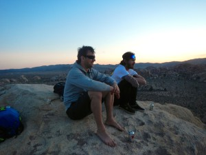 Mox and Mason enjoying sunset on a desert